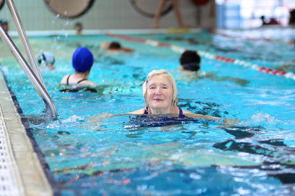 Elderly woman treading water in a pool